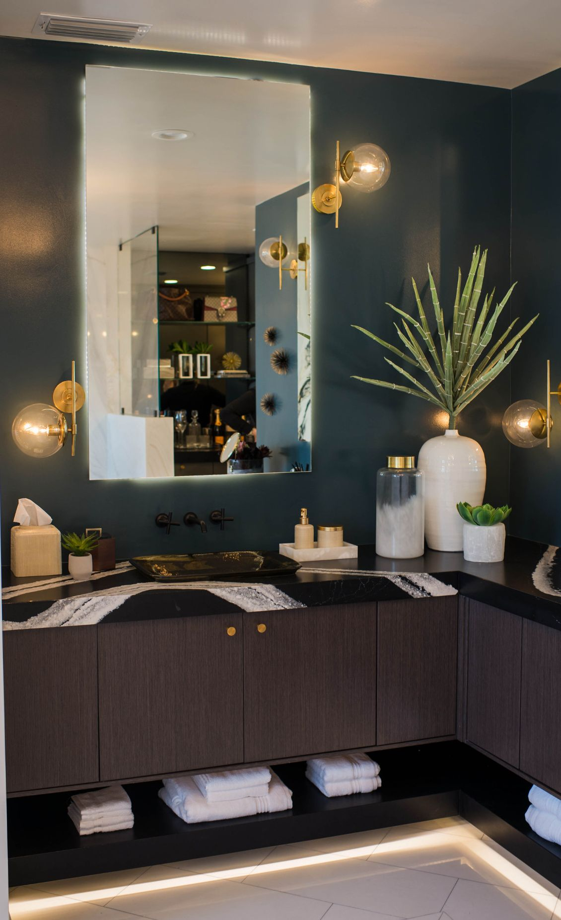 Brass sconces lend an intriguing, bubble-like quality to the space. Space featuring Cambria Mersey and Blackpool Matte