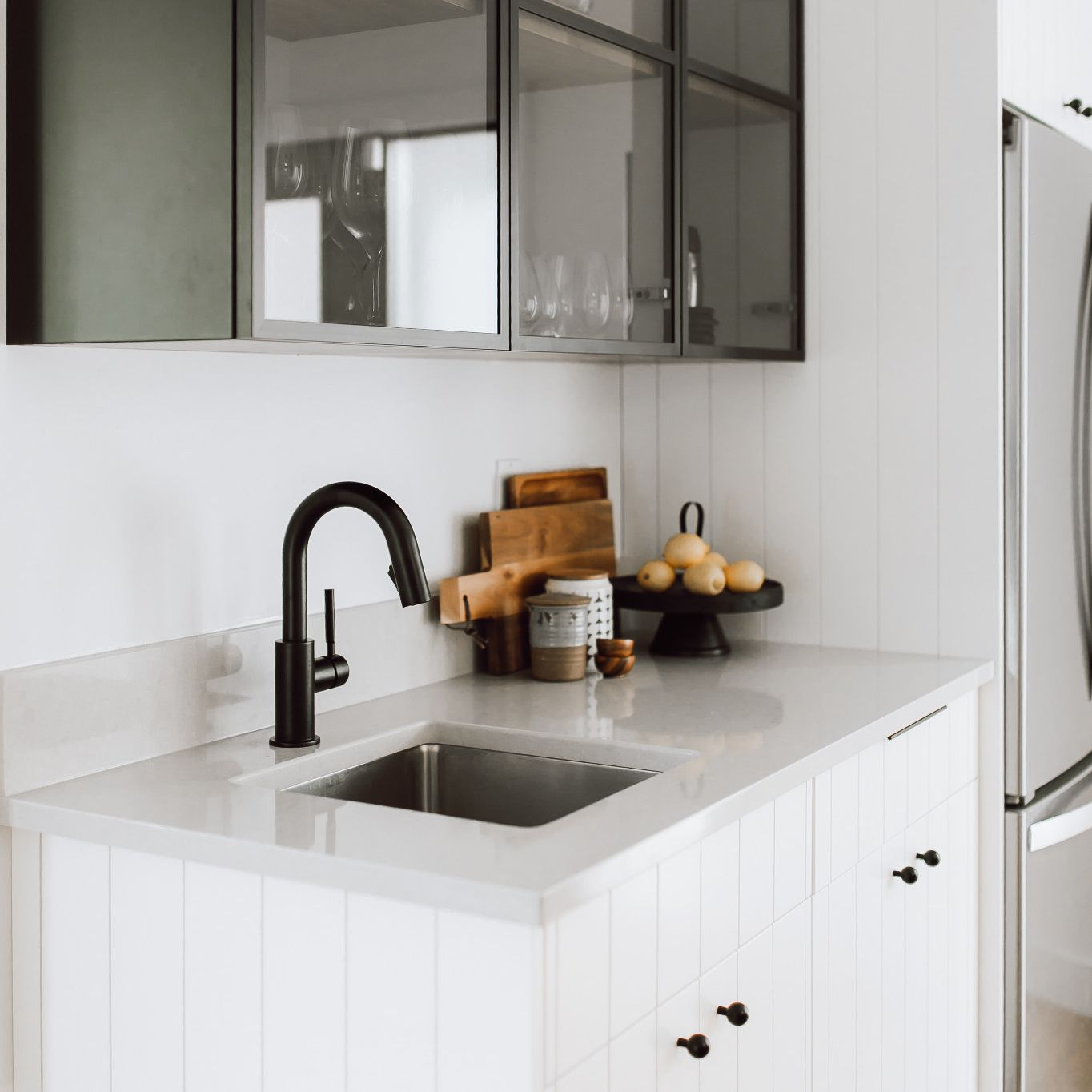 Cambria Templeton  wet bar with white cabinets.