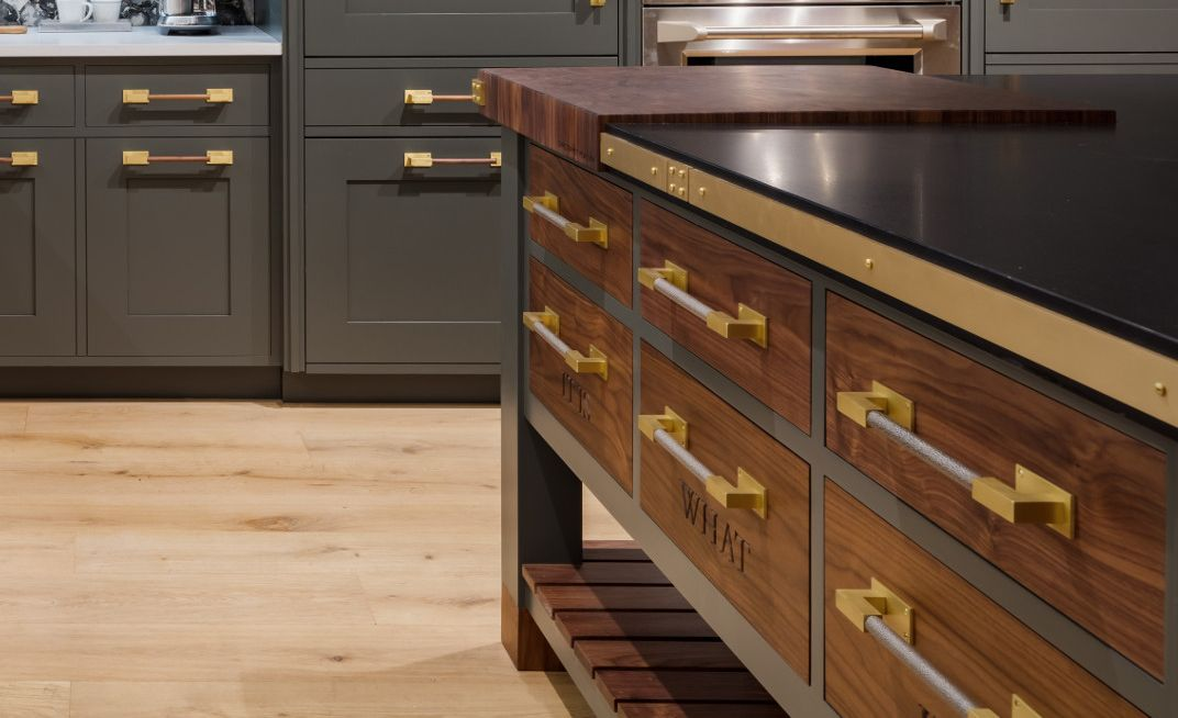 Cambria Blackpool Matte countertops and with custom walnut drawers and brass accents.
