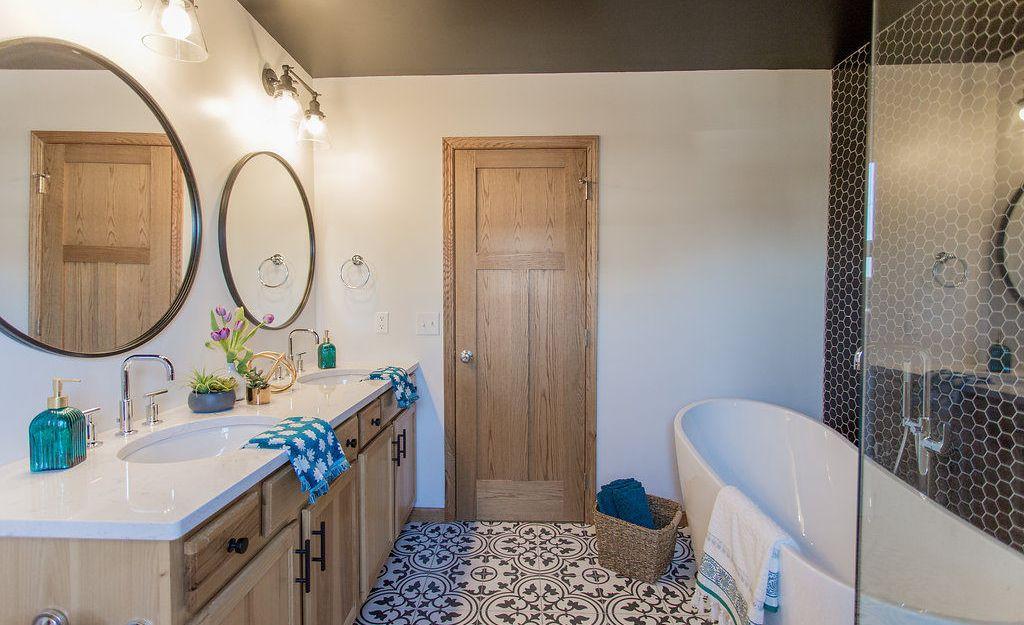 Farmhouse bathroom remodel featuring Cambria Swanbridge countertops.