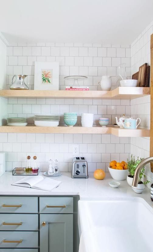 Open-shelving crated an airy feel in this kitchen featuring Cambria Ella countertops.