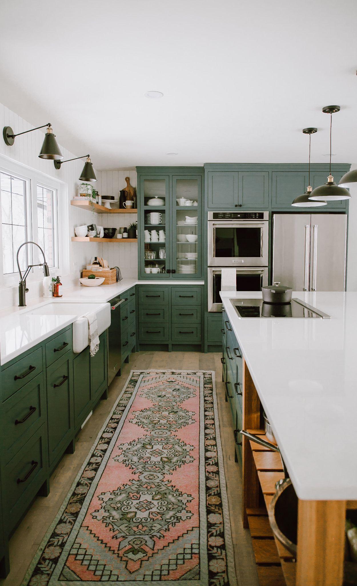 Green and white farmhouse kitchen with Cambria Newport™.