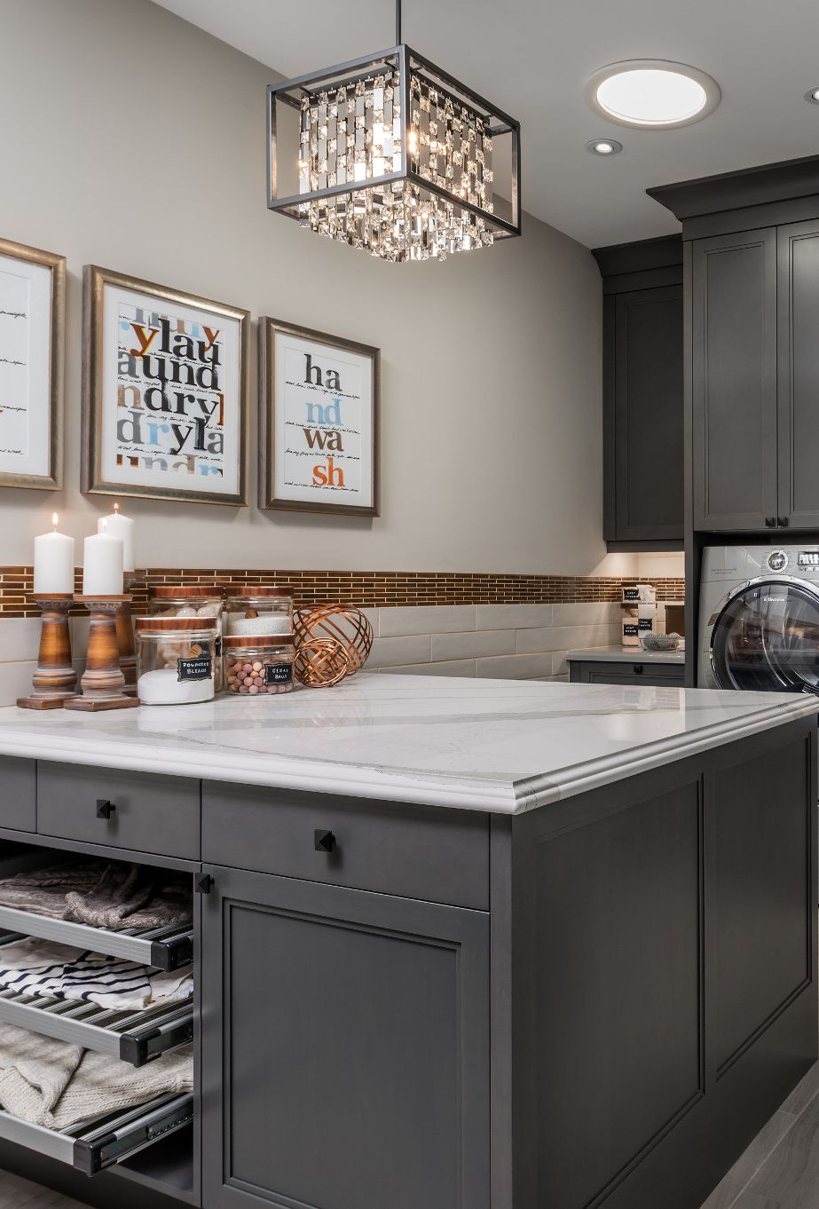 Cambria Brittanicca countertops in a neutral toned laundry room.