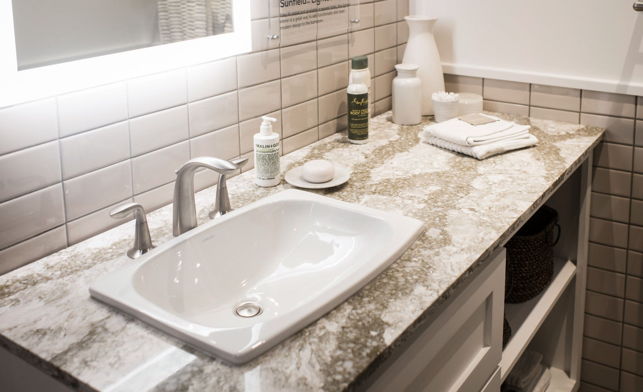 Cambria Beaumont™ bathroom countertops create a warm greige palette.