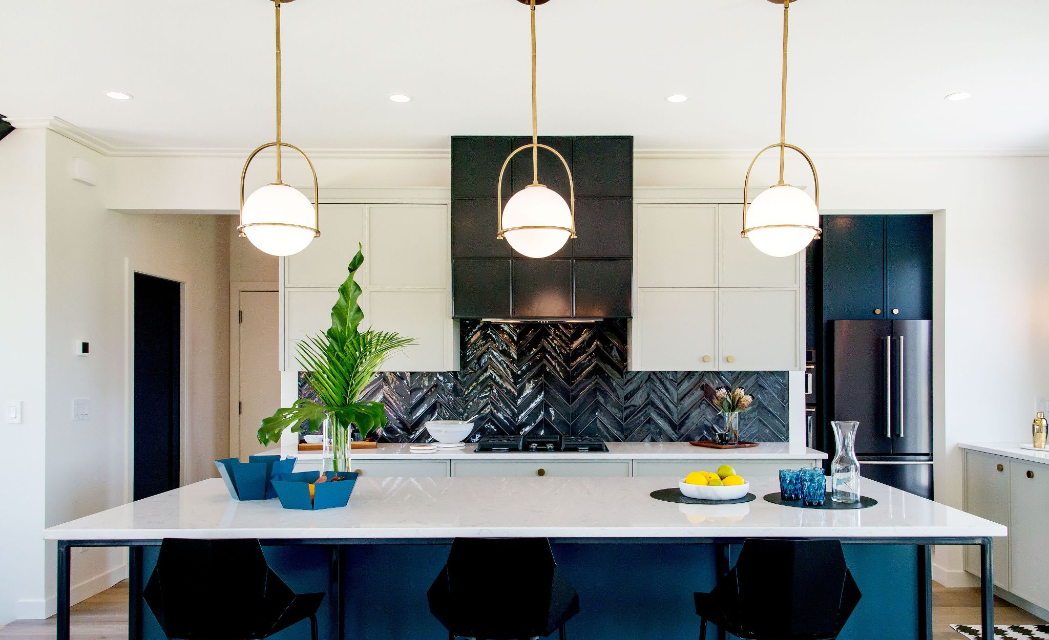 Blue, black, and white kitchen featuring Cambria Swanbridge.