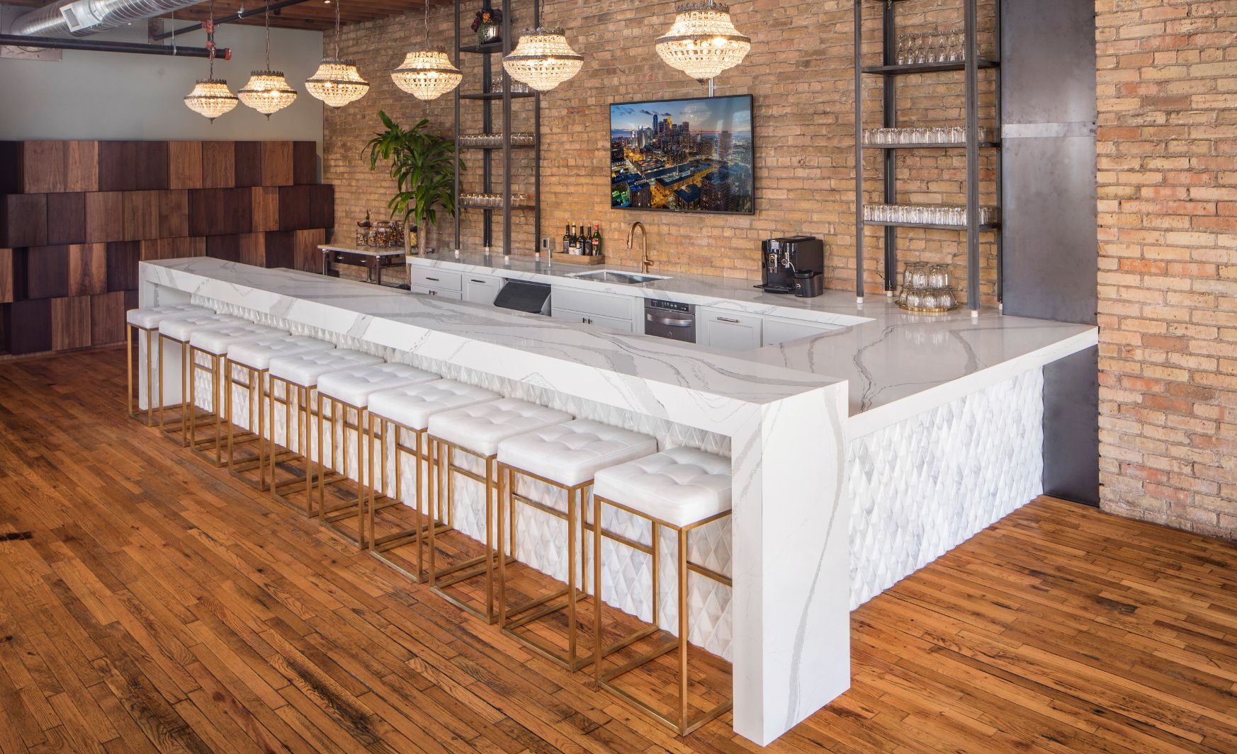Cambria Brittanicca makes a durable waterfall-edge bar at this event center.