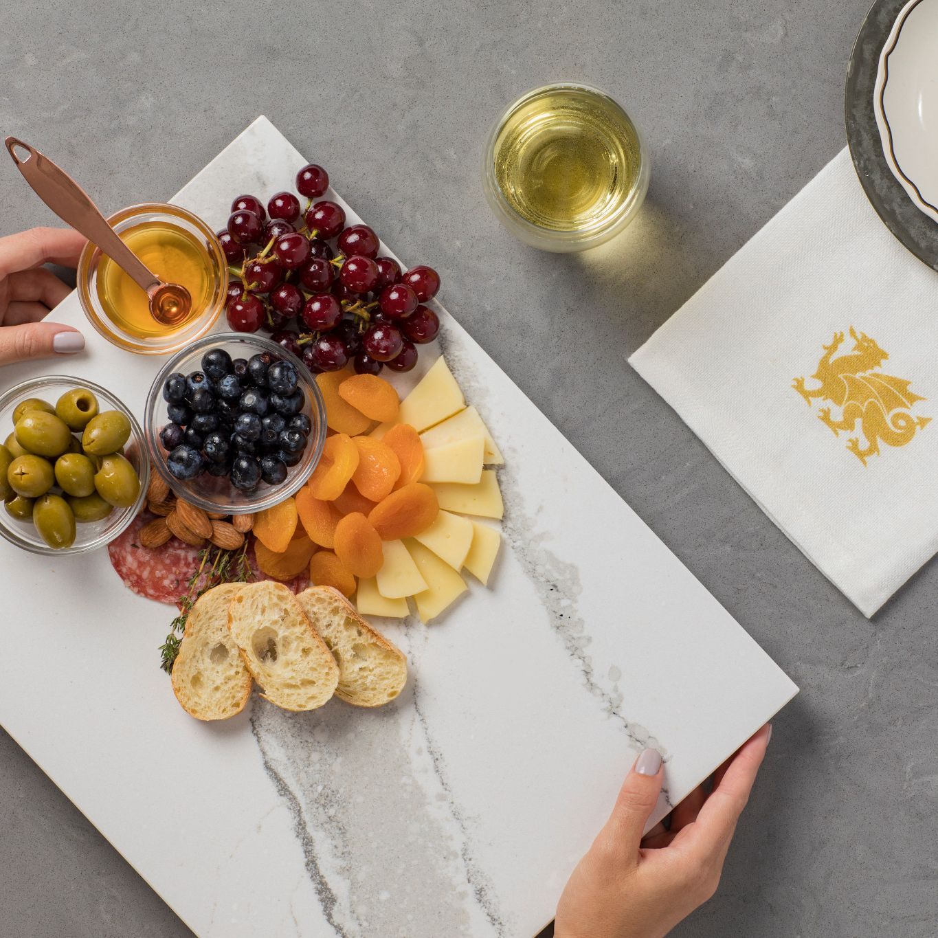 Cambria Brittanicca cheese plate being placed on a table.