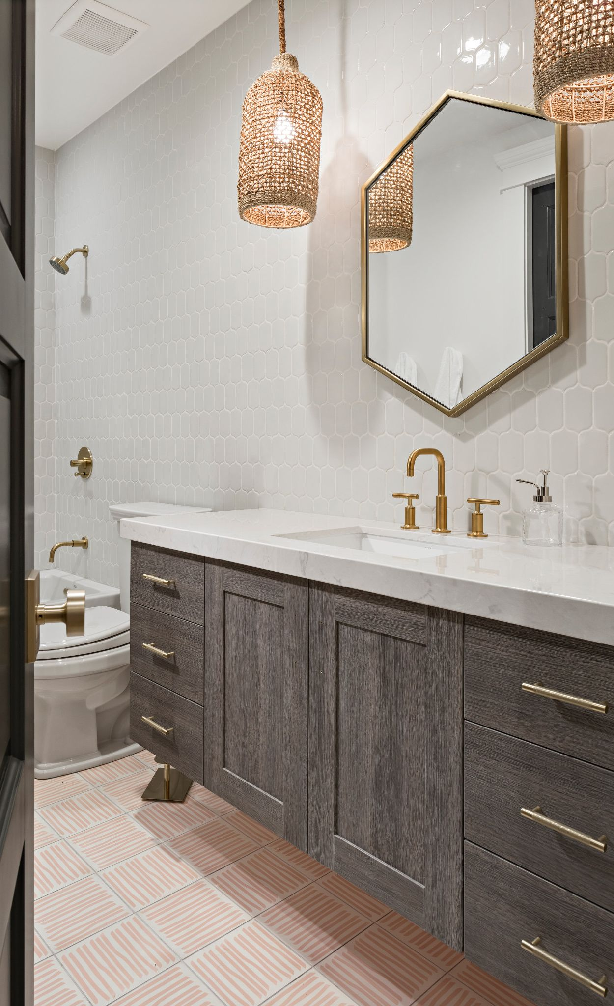 Pair a wood cabinet vanity with Cambria Swanbridge and geometric shapes.