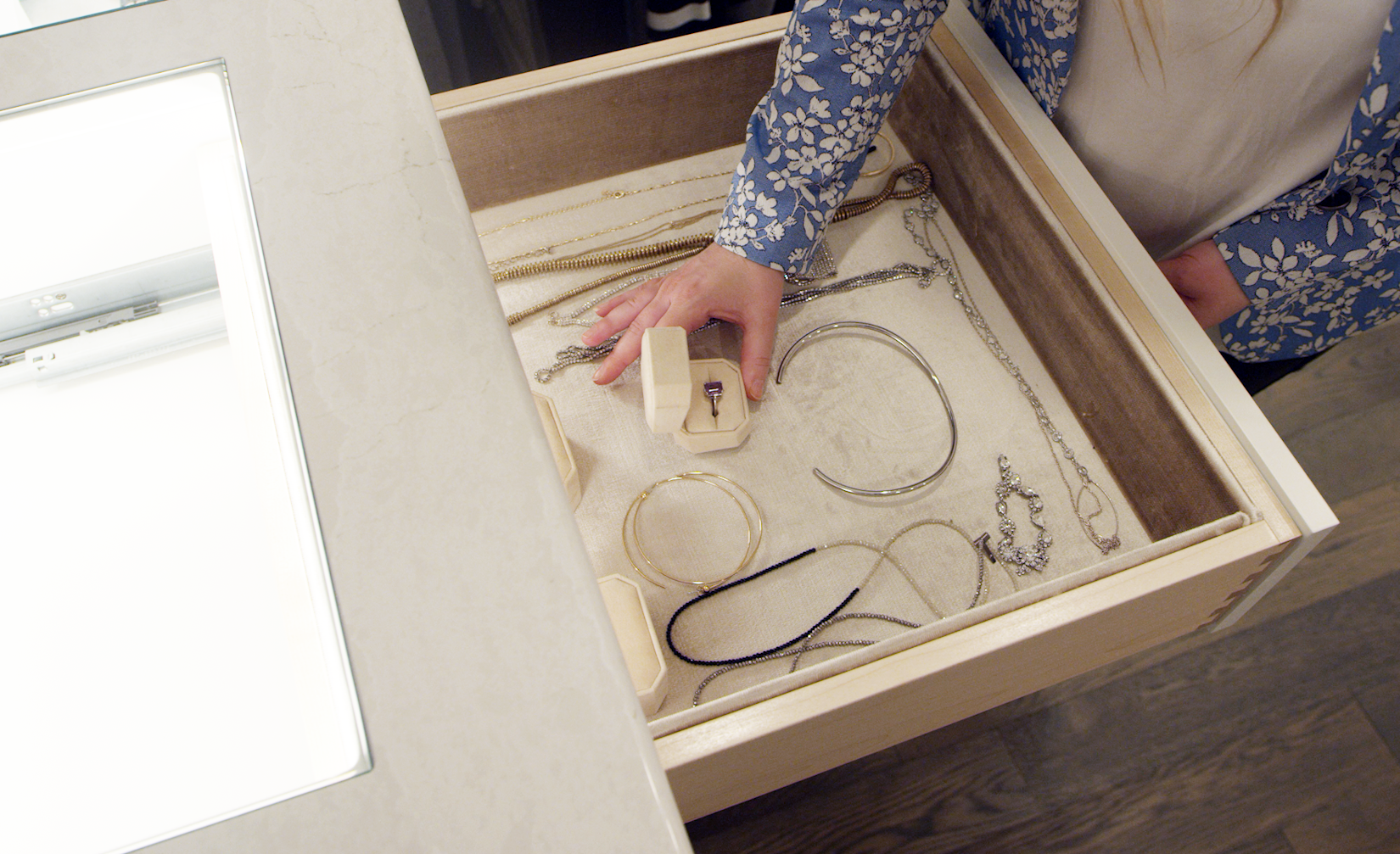 Carly Zucker shows a detailed view of an organized jewelry drawer.