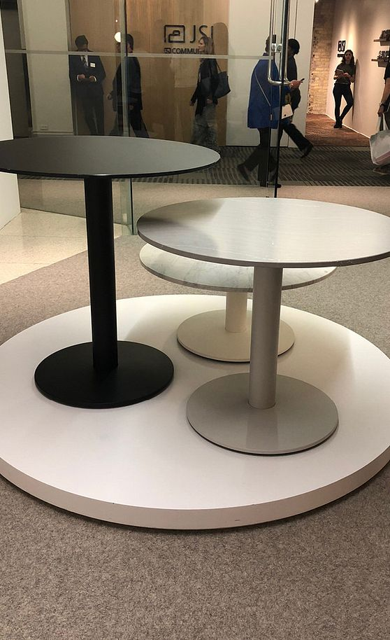 Create a custom space with tables made out of Cambria.