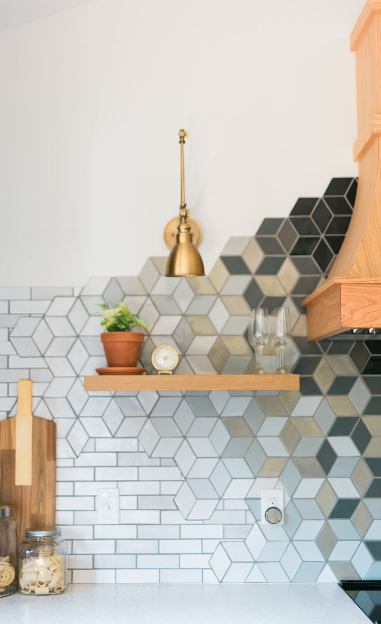 Bold mosaic-tile backsplash paired beautifully with Cambria Delgatie.