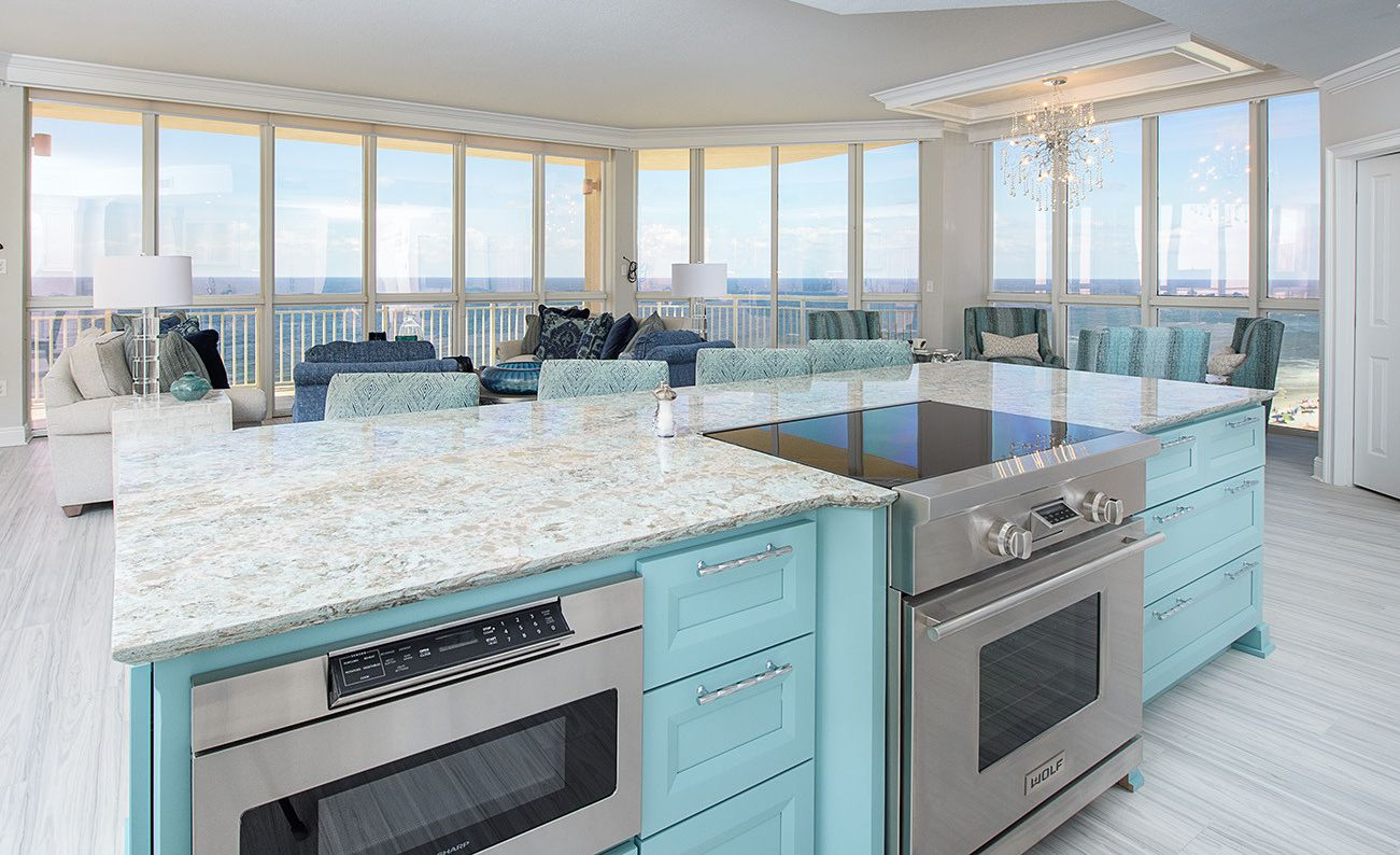Coastal kitchen island with Cambria Kelvingrove countertops.