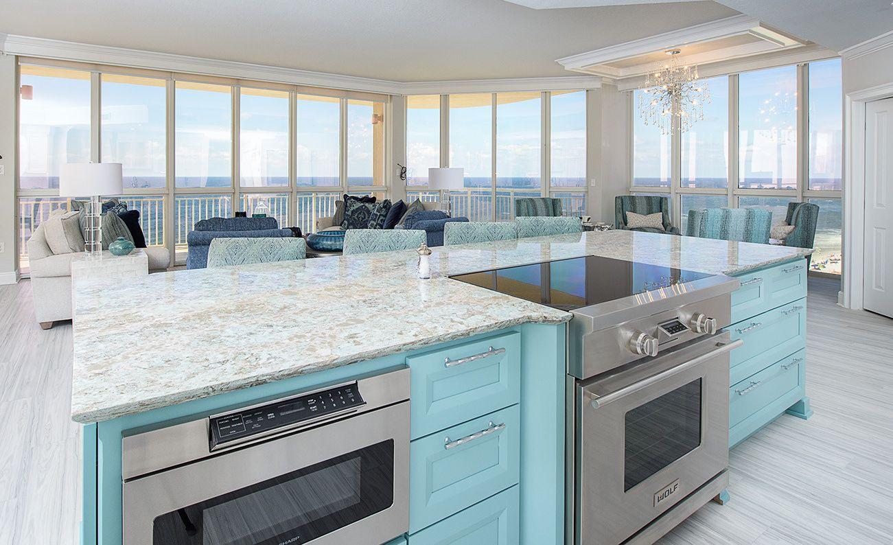 Coastal kitchen island with Cambria Kelvingrove countertops.