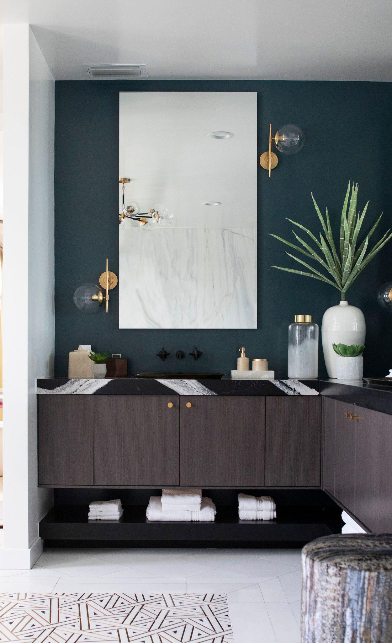 Stunning black quartz countertops in Cambria Mersey™ create a glam master bathroom.