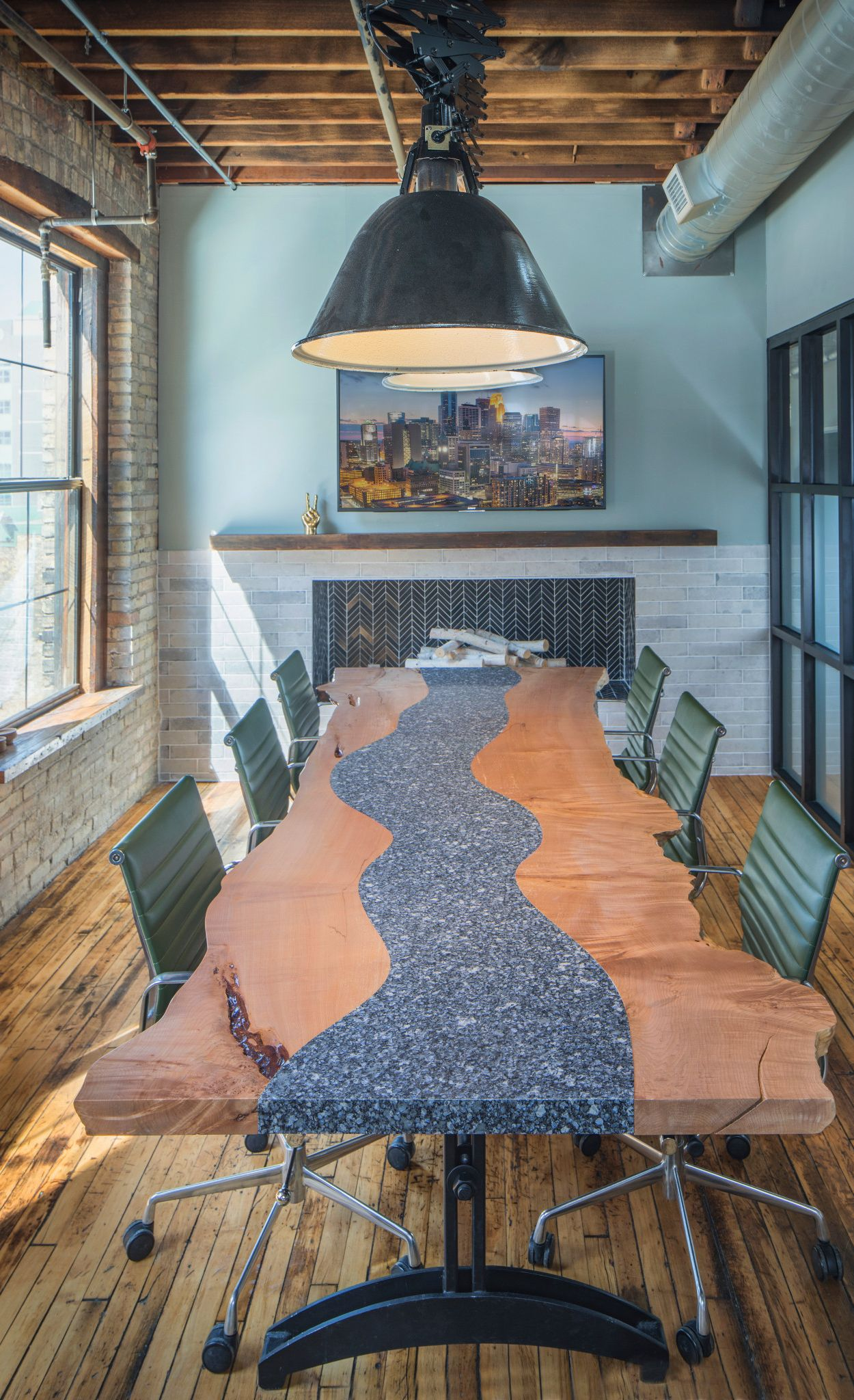 Custom Parys table combine with wood for a modern meeting space.
