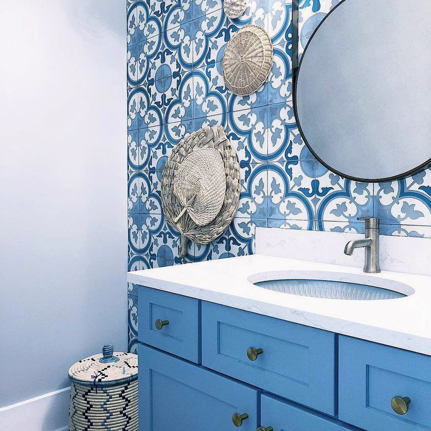 Cambria Swanbridge paired with a blue mosaic backsplash.