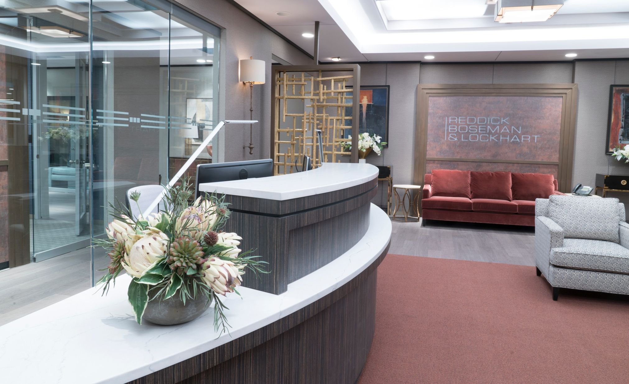 "Law firm office reception desk with Cambria Ella Matte countertops on the set of CBS's ""The Good Fight."""
