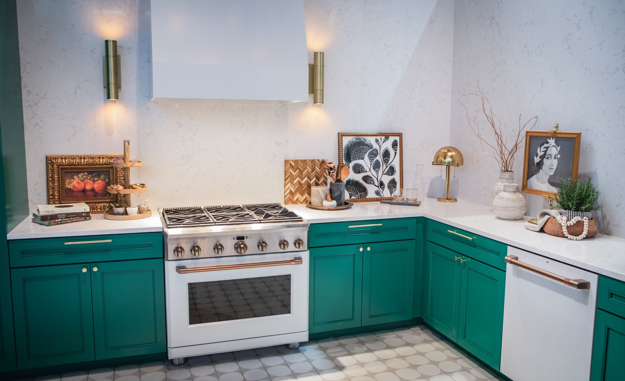 White appliances with brushed copper hardware paired with mixed metals, green cabinetry, and a Cambria Torquay backsplash and countertops.
