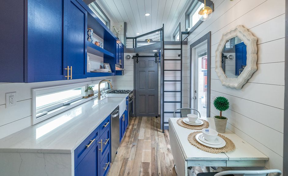 A stunning, blue tiny home with Cambria Ella countertops.