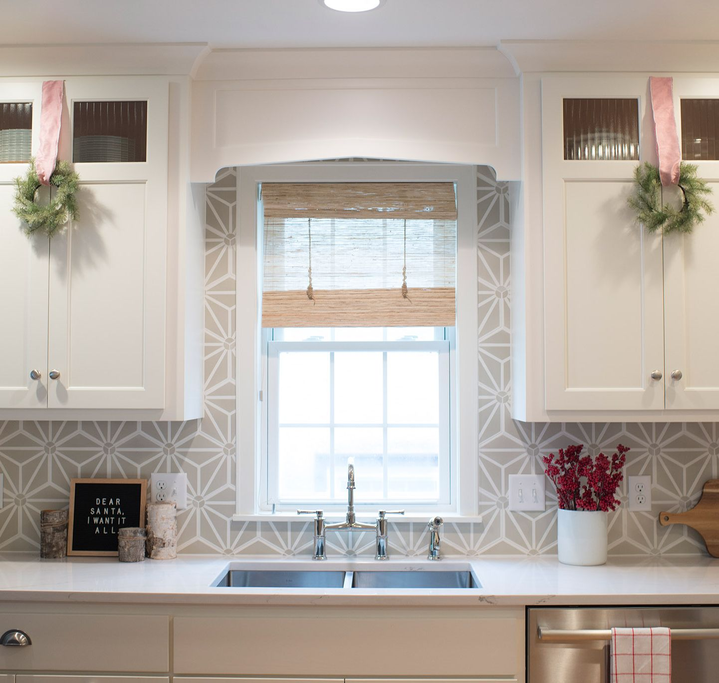 A red and white palette creates Christmas simplicity in this kitchen featuring Ella