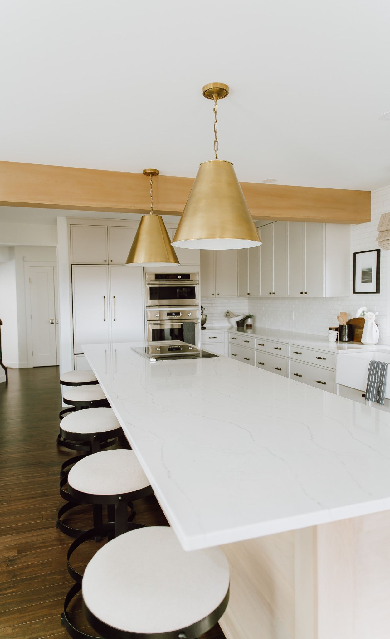 Cambria Ella kitchen island paired with wood cabinets.