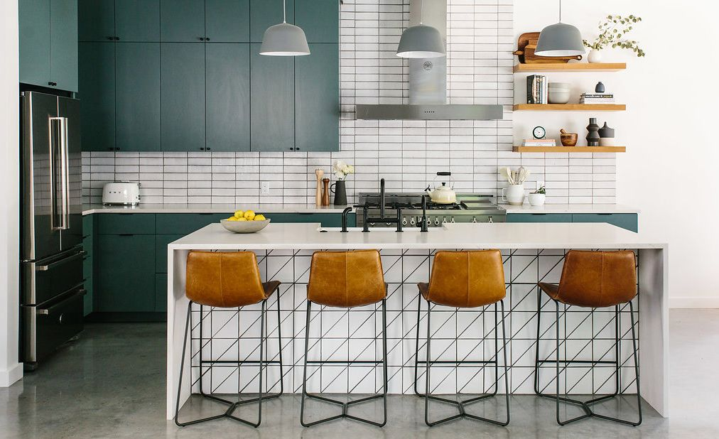 Cambria Ella Matte paired with geometric tile in a green kitchen.
