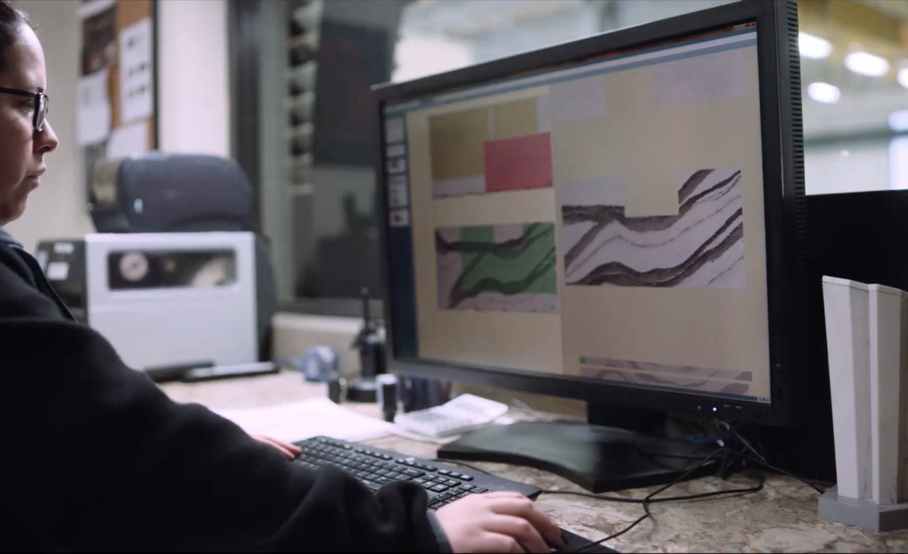 A Cambria employee uses computer software to create outlines for a slab