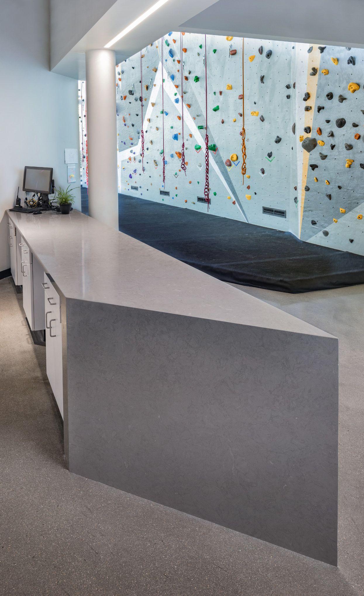 Concrete alternative reception desk in a wellness center featuring Cambria Carrick.