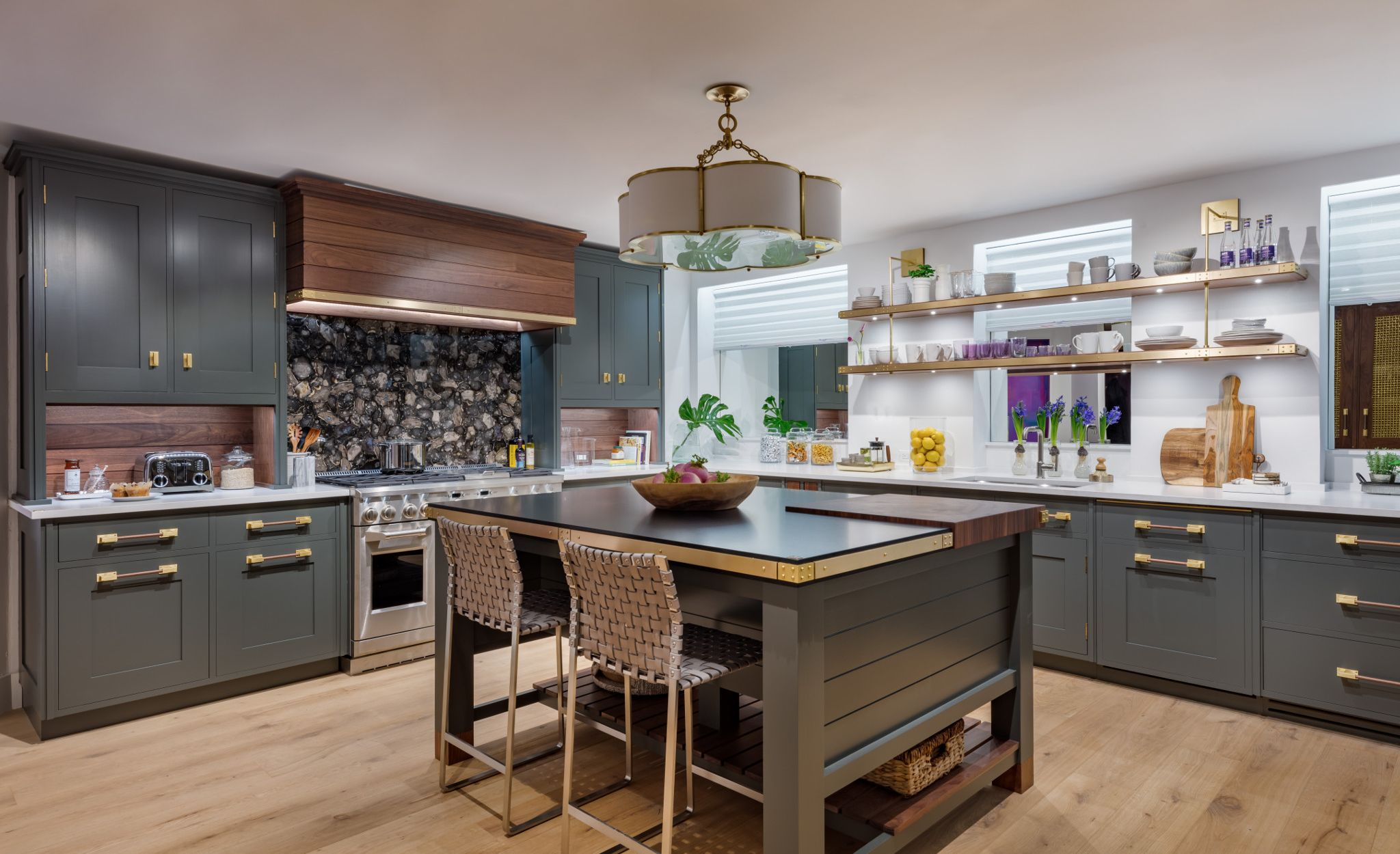Olive green cabinetry, inspired by the designer's mother, pairs with Cambria Blackpool Matte and Cambria White Cliff Matte in the 2019 Kips Bay New York kitchen.