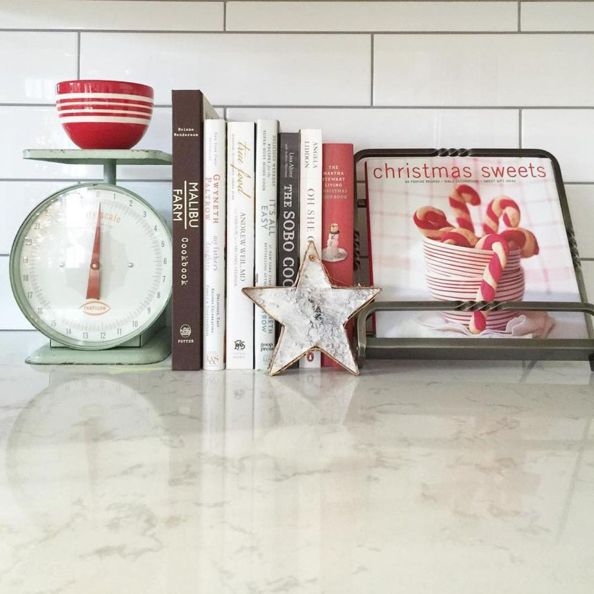 Utilize colorful cook books when decorating your kitchen for Christmas.