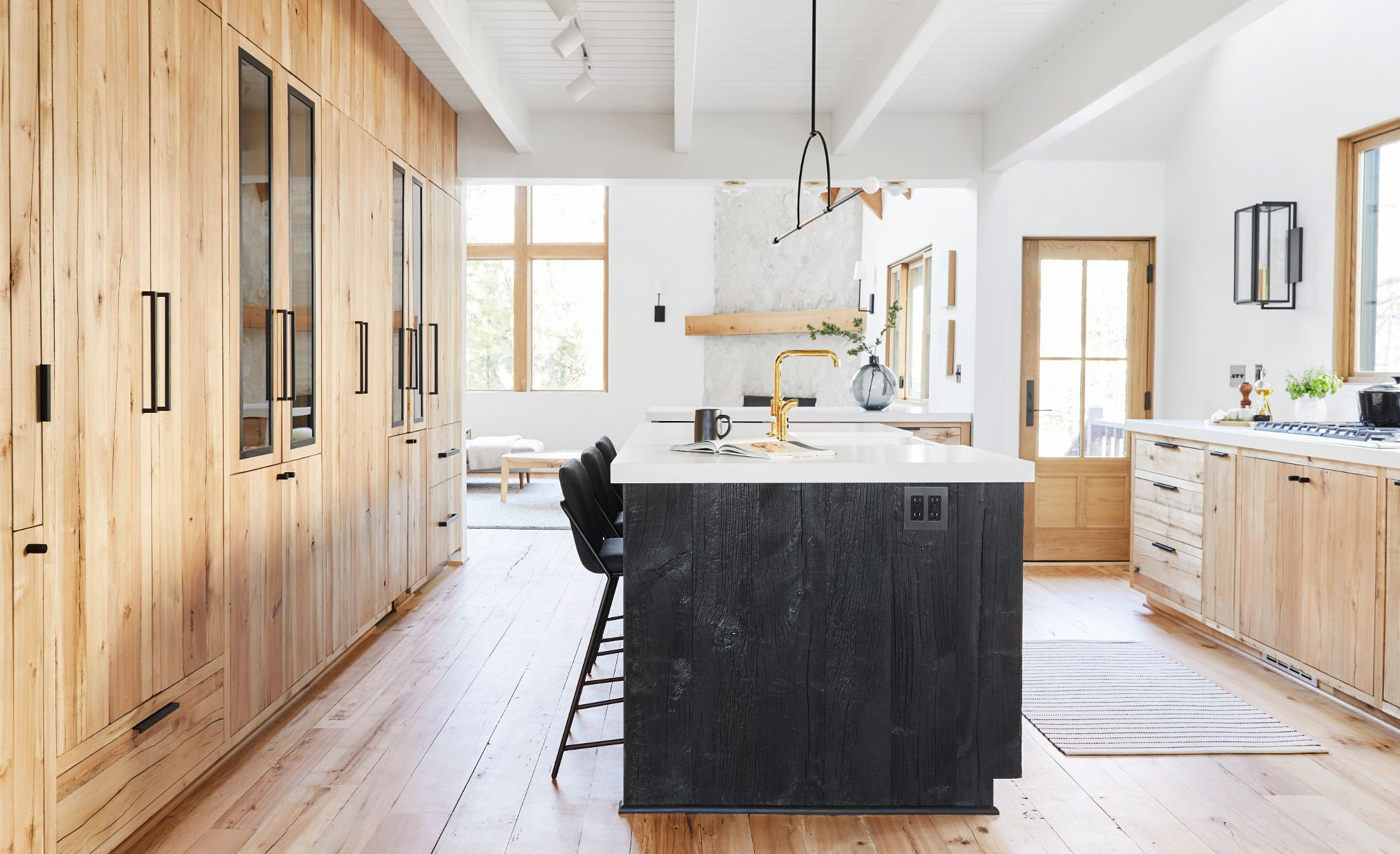 Cambria White Cliff Matte paired with light wood and black stained cabinets.
