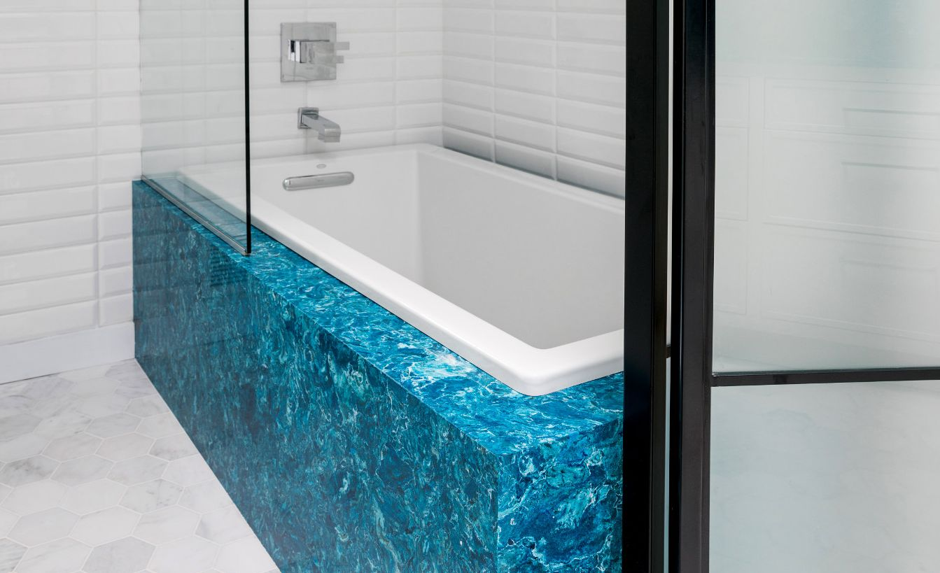 Bright blue Cambria Skye tub surround.
