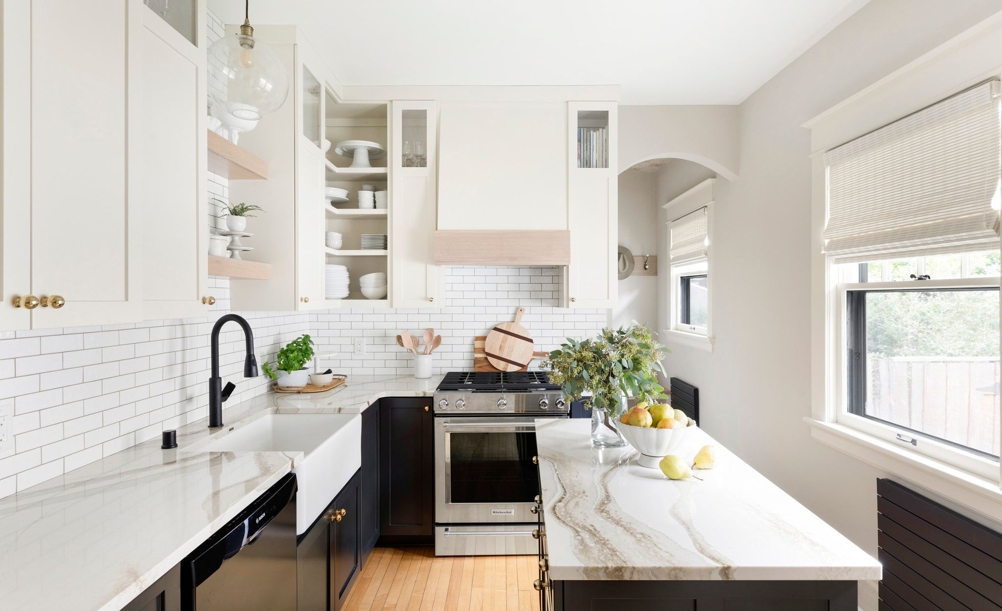 White marble-look quartz countertops paired with white upper and black lower cabinets.