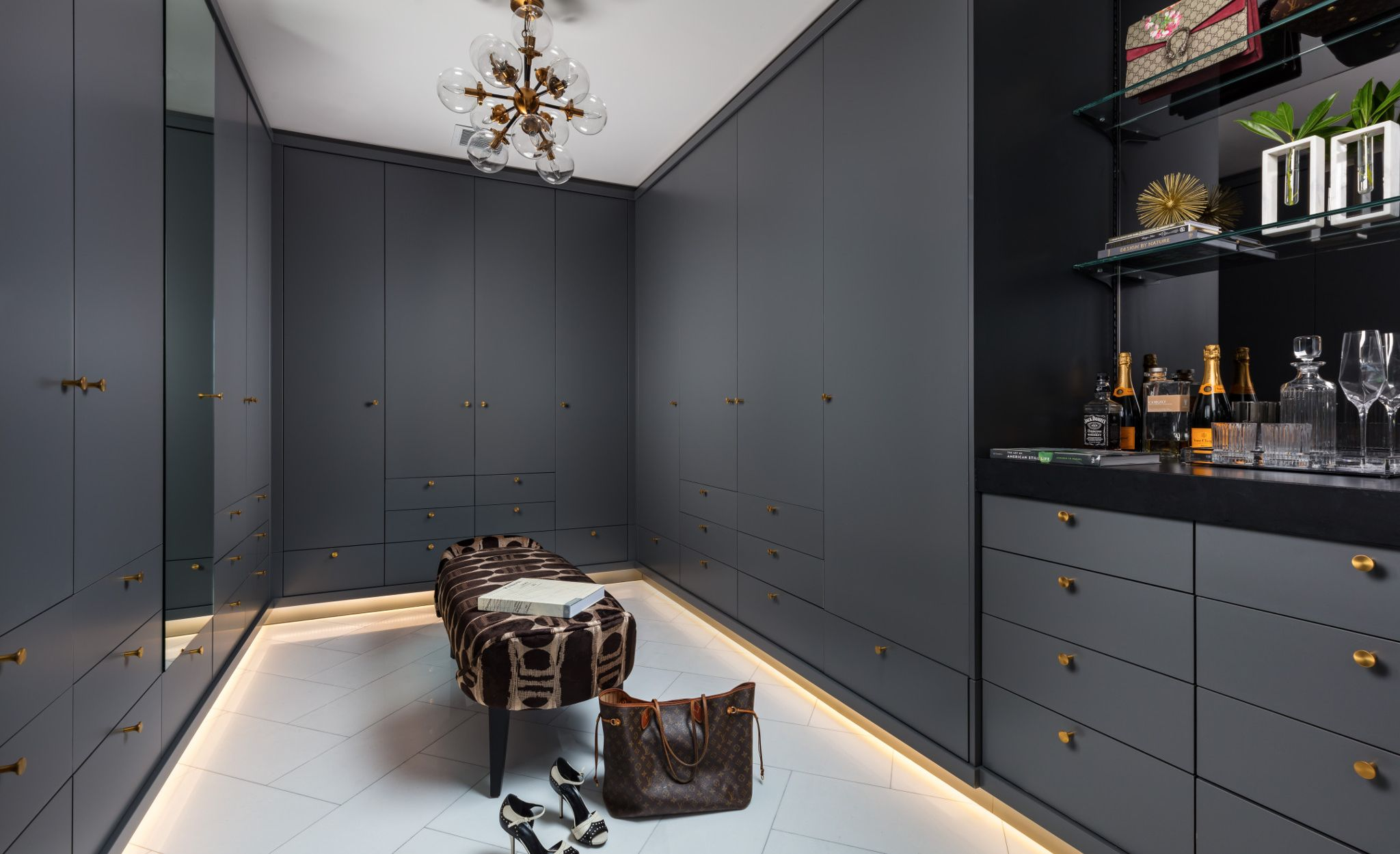 A stylish bar area with Cambria Blackpool Matte transforms a dressing room into a celebratory space.