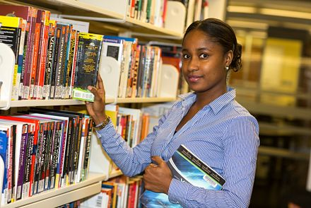 Student in library with books