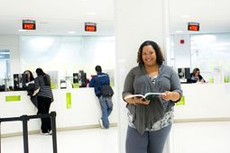 Photo of a female student in the student hub at progress campus