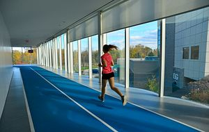picture of a Centennial College student running on the track in the athletic and wellness centre