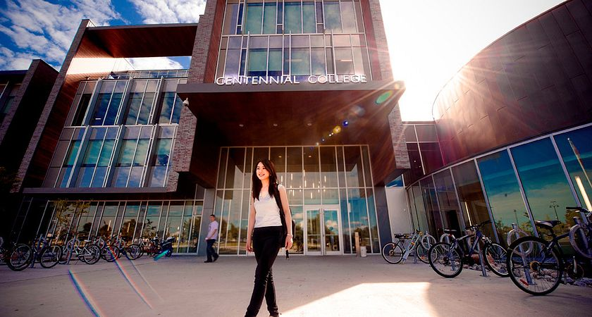 picture of a Centennial College student standing outside the Progress Campus library