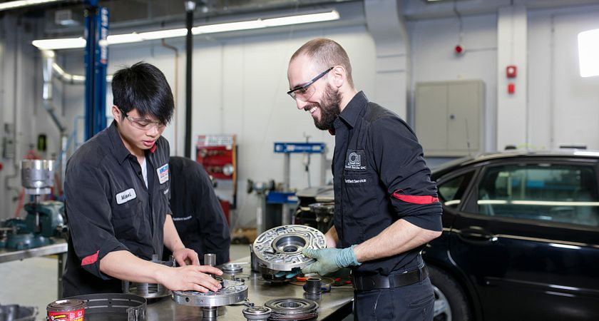 picture of Centennial College Automotive Service Technician Canadian Tire modified apprenticeship program students working in a garage with car parts