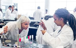 picture of two centennial college microbiology students working in a science lab