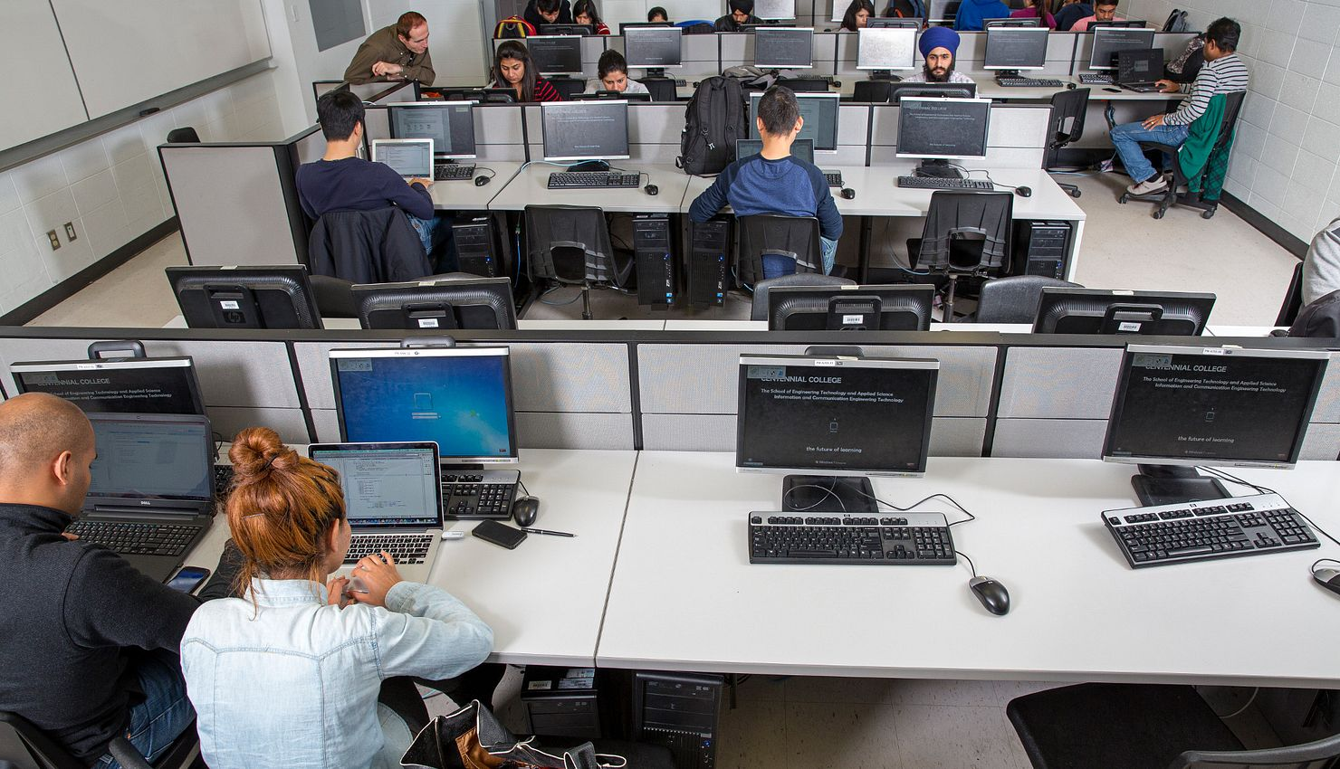 Picture of Centennial College students at the computer lab