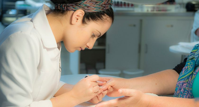picture of a centennial college esthetician student giving a manicure
