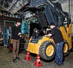 Heavy-Duty-equipment students working on a large vehicle
