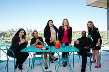 Picture of a Centennial College Events Management faculty team enjoying coffee on the balcony at the top of the Events Centre