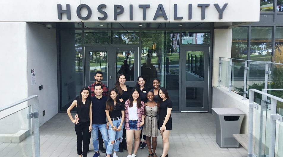 hospitality students in front of residence and culinary arts centre