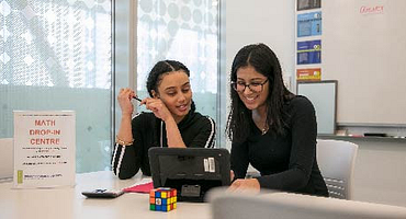 student and tutor in the math drop-in centre