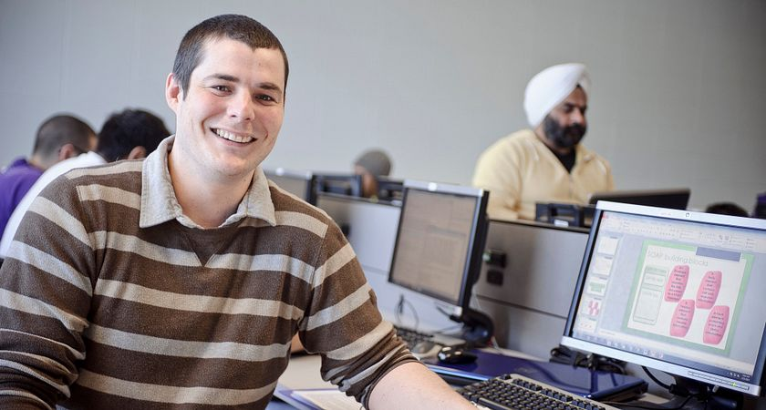 engineering technology student at a computer