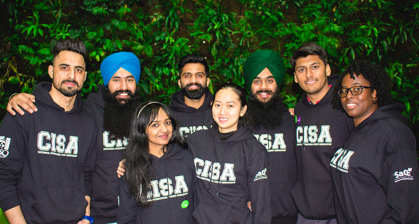 A group of Centennial International Student Ambassadors while wearing CISA shirts