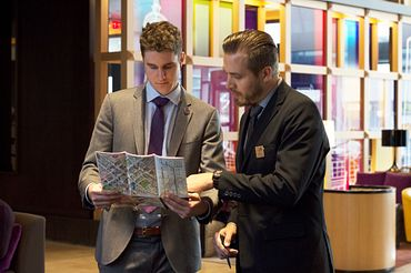 picture of a centennial college graduate assisting a guest at a hotel