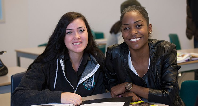 picture of two Centennial College Community Development Work program students in class